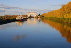 View of the lock on the Volga river near Uglich. Autumn nature. View of the lock on the Volga river near Uglich, Russia. Yellow autumn trees reflected in blue stock images