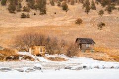 View of log huts at the shore in Lake Baikal Royalty Free Stock Photos