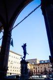 View of Loggia dei Lanzi wiht bronze statue of Perseus holding the head of Medusa by Benvenuto Cellini in Piazza della Signoria. In front of Palazzo Vecchio stock photos
