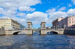 View of Lomonosov Bridge across Fontanka River, St. Petersburg, Russia. SAINT PETERSBURG, RUSSIA - MAY 3, 2017: Excursion ship on Fontanka River near Lomonosov stock images