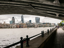 View of London buildings from under archway of Blackfriars Bridg Royalty Free Stock Images