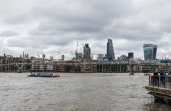 View of London construction cranes from Thames River Stock Photography