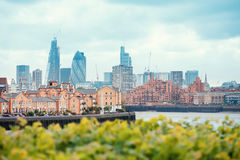 View of London Docklands with the Thames River, downtown, cucumber and city center. Real estate buildings suburbs stock image