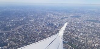 Lufthansa Airplane Flying Over London royalty free stock photography