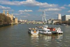 View of London Eye over Lambeth Bridge across River Thames Stock Image