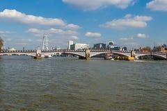 View of London Eye over Lambeth Bridge across River Thames Stock Photo