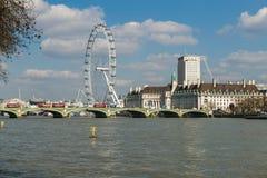 View of London Eye over Lambeth Bridge across River Thames Royalty Free Stock Photography