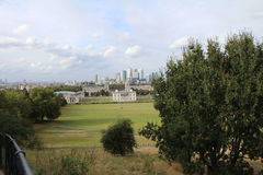 View of London from Greenwich Park. Trees and Railing in Greenwich Park overlooking London Stock Photo