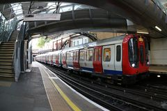 View of London underground train arriving at station - image stock photo