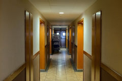View of the long corridor in a hotel Stock Images