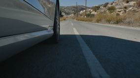 The view of long road from riding car stock footage