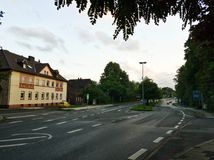 View of a long wide street in Bochum. Photo of a view of a one of the major streets in Bochum, Germany made in the evening Stock Photos