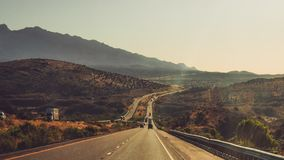 American Road Trip Long Window Road With Mountains stock photography