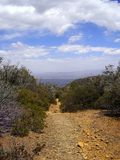 View looking back down a hiking trail toward a valley below royalty free stock photos