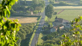 View looking down on French country road with cars, Castelnaud, Dordogne, Aquitaine stock footage