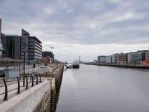River Liffey from Samuel Beckett Bridge towards Dublin Docks and Poolbeg Chimneys. View looking down the River Liffey from Samuel Beckett Bridge towards Dublin royalty free stock photo