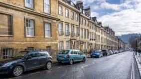 View looking down row of terraced Georgian houses in Gay Street, Bath, Somerset royalty free stock images