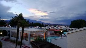 Villas at Southgate in St. George, Utah. The view looking over the pool at out towards the horizon at the Villas at Southgate as storm clouds move in during the stock images