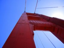A view looking up at a tower on a suspension bridge stock photo