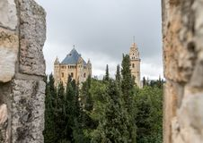 View through the loophole in the city fortress wall at Dormition Abbey in old city of Jerusalem, Israel stock images