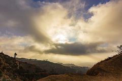 View of Los Angeles hillsides from hiking trail. At sunrise with sunrays stock photo