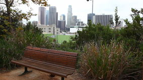 A View of Los Angeles skyline with park bench in the foreground stock video