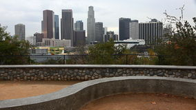A View of Los Angeles skyline with stone dike in the foreground stock video