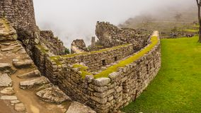View of the Lost Incan City of Machu Picchu inside de fog, near Cusco, Peru royalty free stock photography