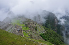 View of the Lost Incan City of Machu Picchu near Cusco.Low cloud Stock Images