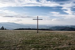 View from Loucka hill in autumn Slezske Beskydy mountains in Czech republic. View from Loucka hill with wooden cross on the summit and meadow in autumn Slezske stock image
