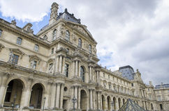 View of Louvre building in Louvre Museum. Museum is housed in Louvre Palace in Paris, France. Stock Images