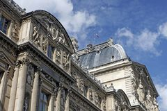 View of Louvre Museum. Louvre, (properly, Mus�e du Louvre), national art museum of France and the palace in which it is housed, located in Paris, on the right Stock Images