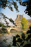 View of the Louvre museum across the Seine River in Paris. Paris, France - October 14 : View of the Louvre museum surrounded with leaves across the Seine River Royalty Free Stock Photography