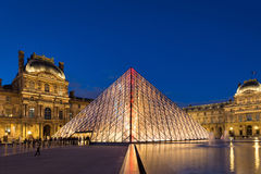 View of the Louvre Museum and the Pyramid at twilight. Stock Image