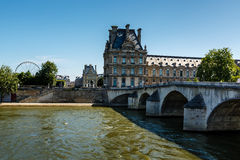 View of Louvre Palace and Pont Royal in Paris Stock Photo