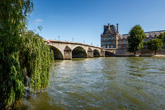 View of Louvre Palace and Pont Royal in Paris Stock Images