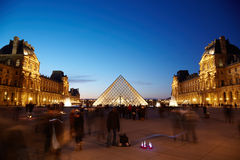 View on Louvre pyramid from inner courtyard side Stock Photos