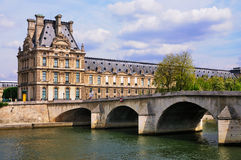 View on Louvre from the Seine. A view on the Louvre museum as seen from the river Seine in Paris, France royalty free stock photography