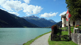 View on the lovely Lago di Poschiavo (Graubunden, Switzerland). Poschiavo (Italian: Poschiavo, Lombard: Pusciaaf, German: Puschlav, Romansh: Puschlav) is a Stock Images