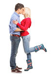 A view of a loving couple kissing. On white background Royalty Free Stock Photos
