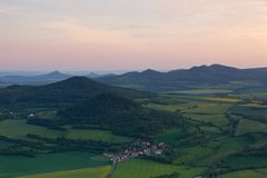 View from Lovos Hill on Velemin village. Sunset  in Central Bohemian Highlands, Czech Republic. View from Lovos Hill on Velemin village.Sunset  in Central royalty free stock photos