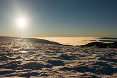 View of a low clouds and sunset on winter mountain ridge Stock Photography