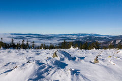 View of a low clouds on winter mountain ridge Stock Photos