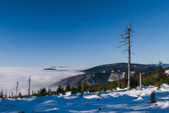 View of a low clouds on winter mountain ridge Stock Image