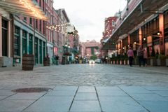 South Street Seaport Roadway. View from low to the stone or brick work roadway in a historic district in South Street Seaport in New York City, Manhattan. Lights royalty free stock photography