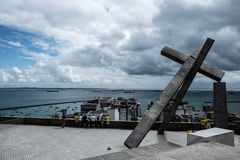 View at the lower city of Salvador de Bahia/Brazil with the Bay. 'The fallen cross' Artwork in the old Town of salvador de bahia/Brazil. Erected at the place of stock photos