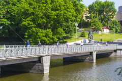 View of Lower lake and footbridge. A favorite place of recreation for residents in the city centre of Kaliningrad Stock Photos
