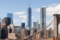 The view of Lower Manhattan from the Brooklyn Bridge. The view of the skyscrapers of lower Manhattan, New York, as seen from the Brooklyn Bridge, being under Royalty Free Stock Images