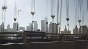 A view of Lower Manhattan skyline filmed in the afternoon from the Uber taxi car driving on the eastern part of the stock footage