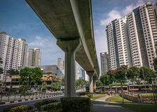 View of LRT rail crossing road junction in a residential district of Bukit Panjang. Stock Photography